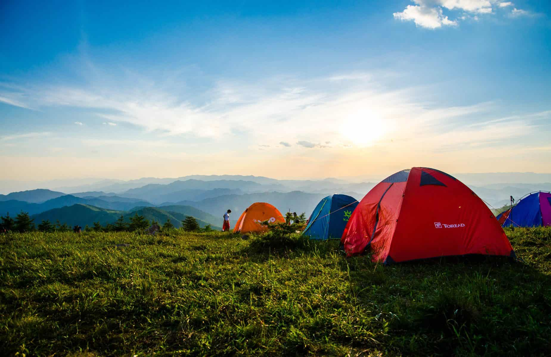 Canva - Photo of Pitched Dome Tents Overlooking Mountain Ranges