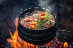 Cooking going on using campfire