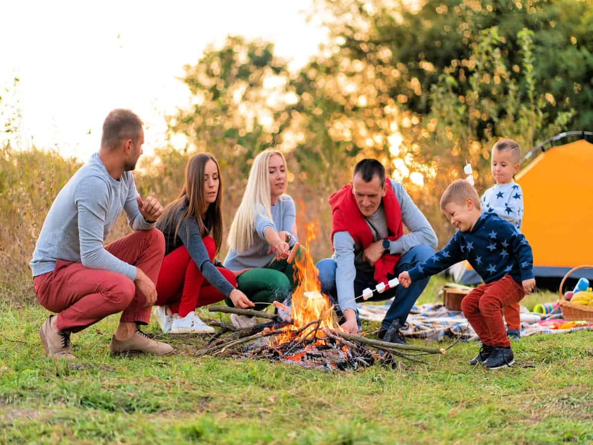 Family with kids enjoying the campfire