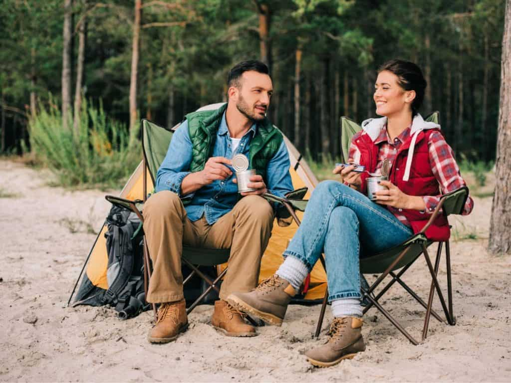 couple sitting on chair in forest