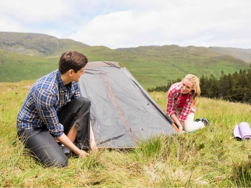 couple setting up the tent