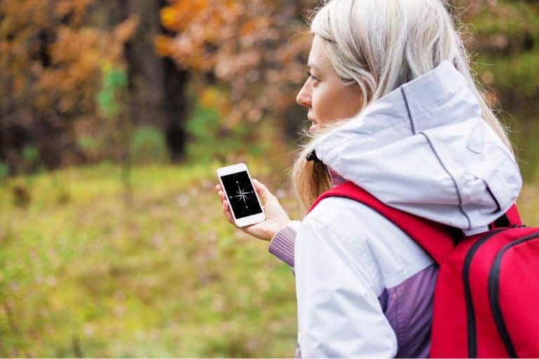 a girl using smartphone as compass