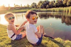2 cute kids doing fishing