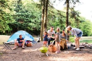 family taking drinks in camp