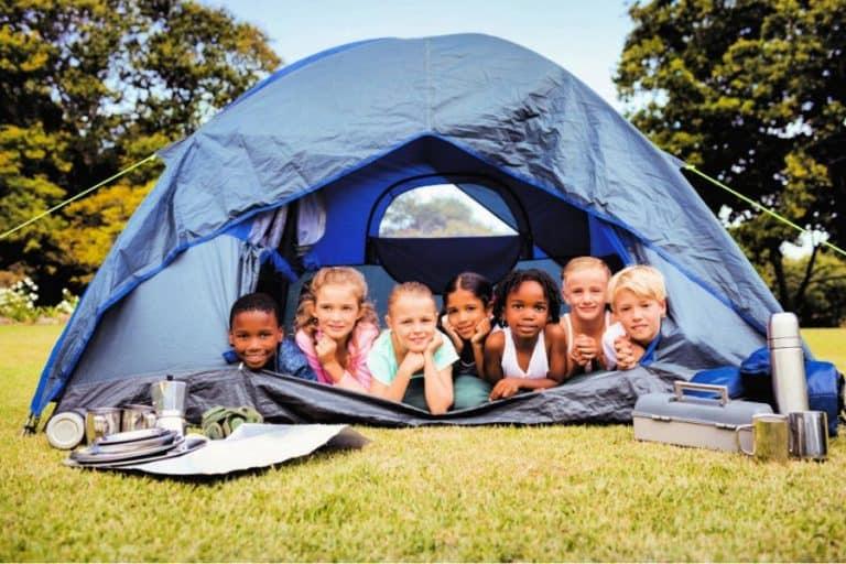 6 kids inside the tent having fun