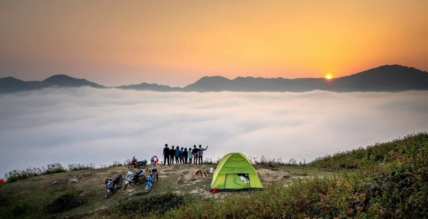 Canva - People Standing on Cliff Looking at Sea of Clouds