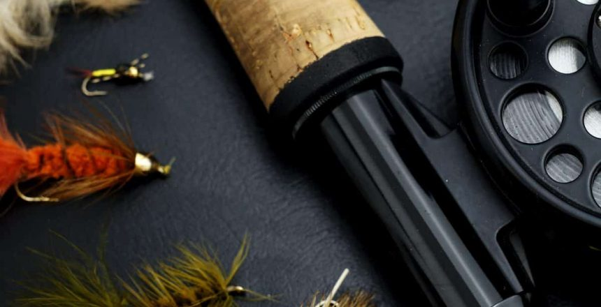 black-and-brown-fishing-rod-beside-hook-and-brown-knife-3690705