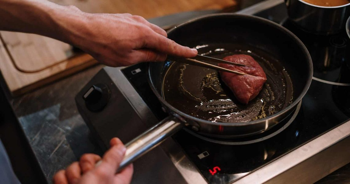 person-cooking-on-black-pan-4253311